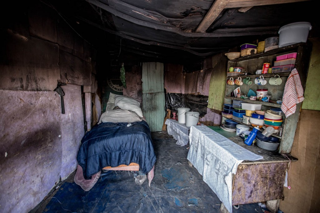 the interior of a family home, in a severely impoverished small informal settlement in Grabouw, Western Cape.