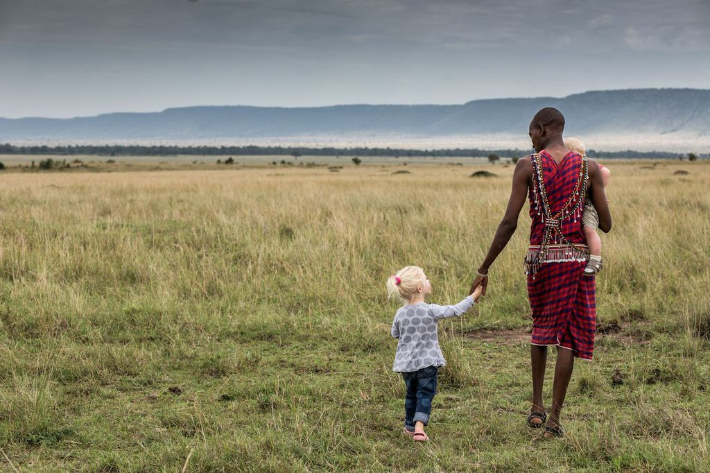 Ethan and Emma on assignment in the Masai Mara with Julius